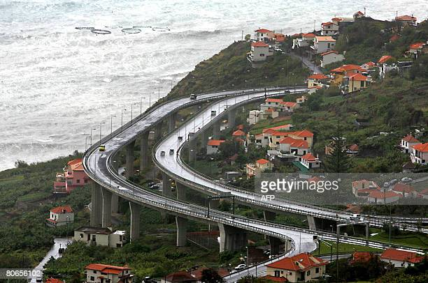 Cars drive on the highway connecting Ribeira Brava to Funchal the capital of the Portuguese autonomous archipelo of Madeira on April 9 2008 Over the...