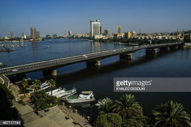 Cars drive on the university bridge over the Nile river in Cairo on October 23 2014 Successive political crises since the early 2011 ouster of...