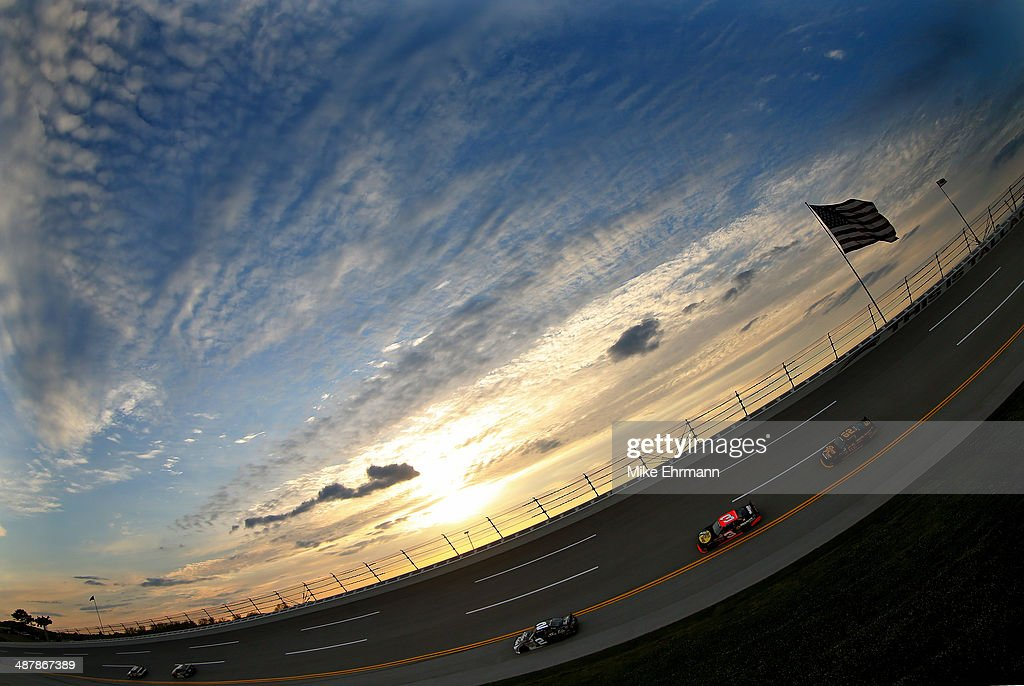 Cars drive on track during qualifying for the NASCAR Nationwide Series Aaron's 312 at Talladega Superspeedway on May 2, 2014 in Talladega, Alabama.
