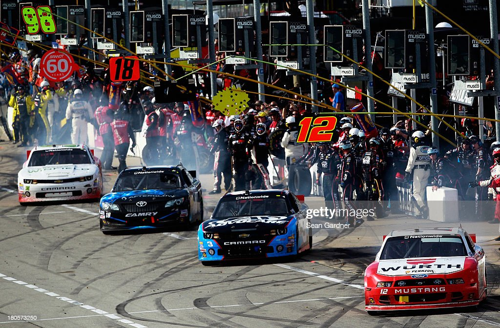 Cars drive out of their pit stalls during the NASCAR Nationwide Series Dollar General 300 Powered by Coca-Cola at Chicagoland Speedway on September 14, 2013 in Joliet, Illinois.