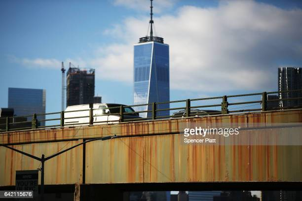 Cars drive over an old bridge in Brooklyn on February 16 2017 in New York City An annual report by the American Road and Transportation Builders...