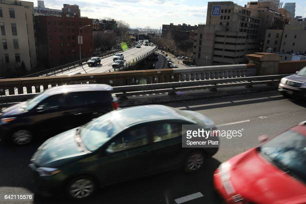 Cars drive over the Brooklyn Bridge on February 16 2017 in New York City An annual report by the American Road and Transportation Builders...