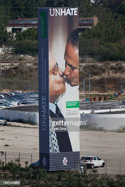 Cars drive past a Benetton Group SpA billboard advertising a composite image of Israeli Prime Minister Benjamin Netanyahu kissing Palestinian...