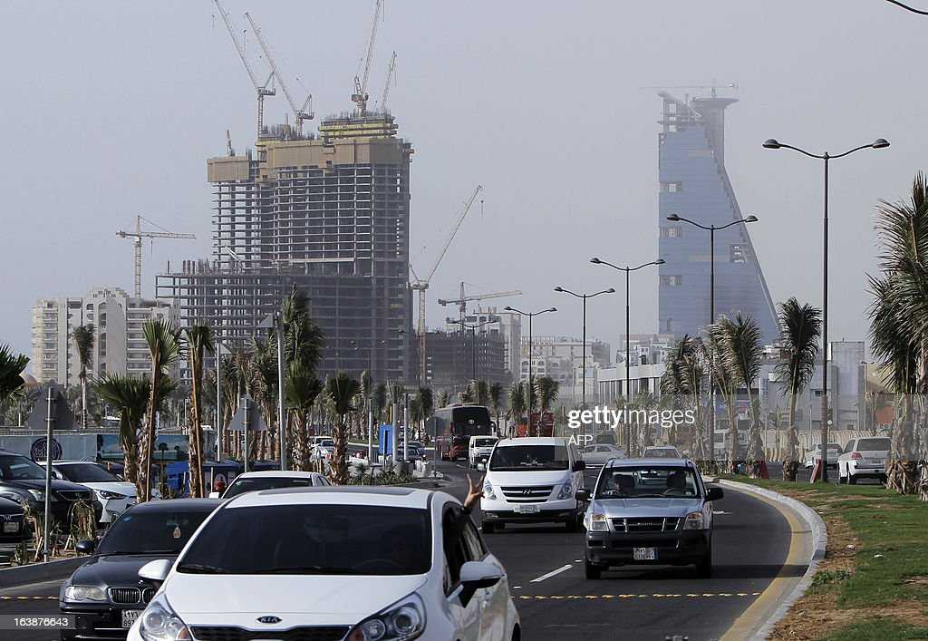 Cars drive past a building under construction in the Saudi coastal city of Jeddah on March 16 2013 Saudi Arabia's housing crisis will be at the...