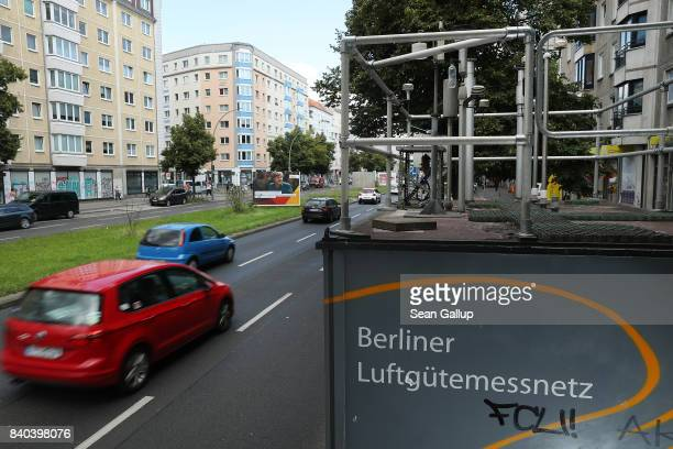 Cars drive past an air quality measuring station on August 28 2017 in Berlin Germany Germany faces federal elections on September 24 and political...