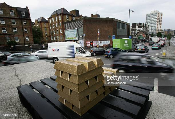 Cars drive past an art installation by Paul Insect entitled 'Bullion' on Old Street roundabout on July 2 2007 in London England