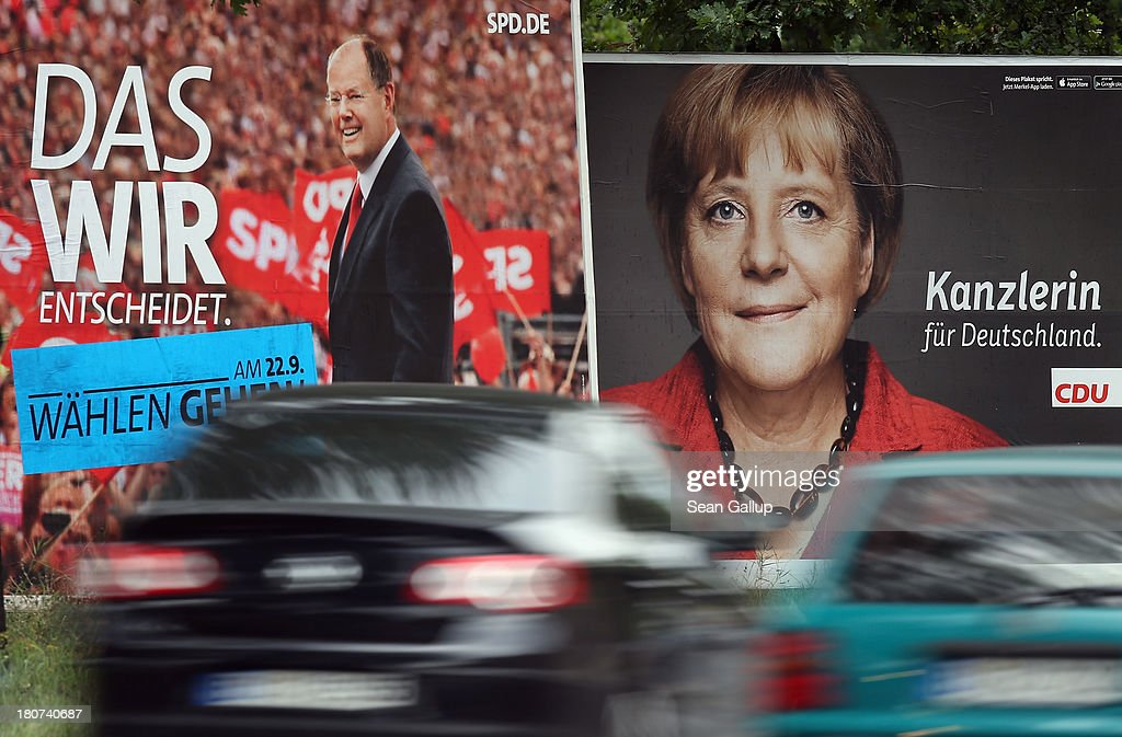 Cars drive past election campaign posters featuring German Chancellor and Chairwoman of the German Christian Democrats (CDU) Angela Merkel (R) and German Social Democrats (SPD) chancellor candidate Peer Steinbrueck on September 16, 2013 in Berlin, Germany. Germany faces federal elections on September 22 and so far the CDU has a strong lead in polls over the SPD, its biggest rival, and other members of the opposition.