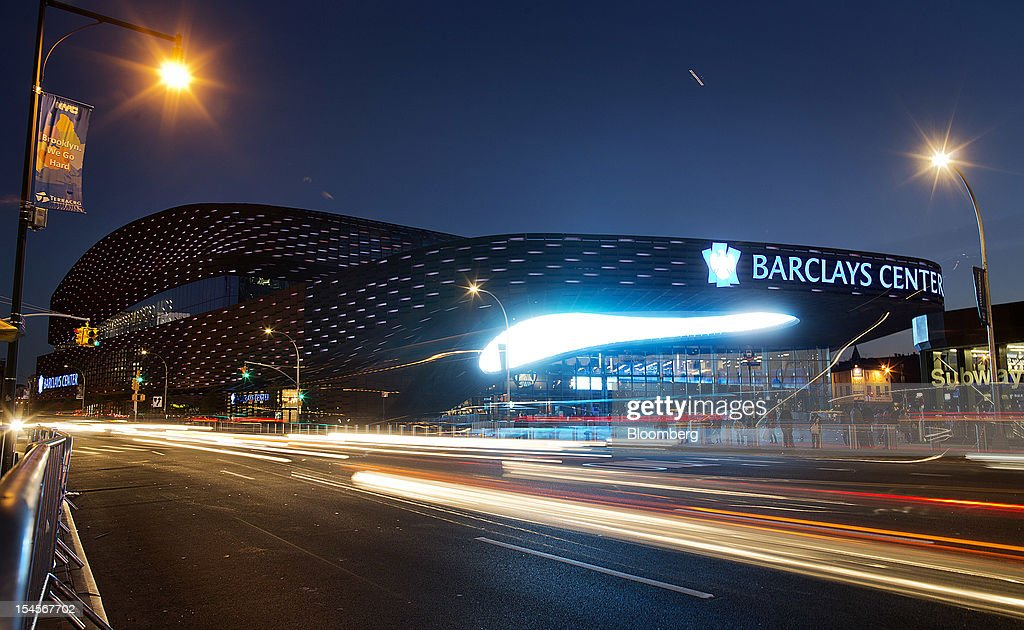 Cars drive past the Barclays Center in the Brooklyn borough of New York, U.S., on Sunday, Oct. 21, 2012. The Barclays Center, the 675,000-square-foot arena designed by SHoP Architects PC of Manhattan, opened on Sept. 28 with eight sold-out shows by rapper Jay-Z. Photographer: Victor J. Blue/Bloomberg via Getty Images