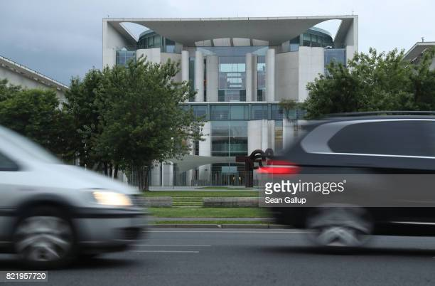 Cars drive past the Chancellery on July 24 2017 in Berlin Germany Three of Germany's biggest carmakers including Daimler which owns the Mercedes...