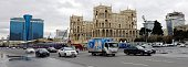 Cars drive past the construction site of the Baku City Circuit pits in central Baku on March 31 2016 The 2016 Formula 1 Grand Prix of Europe will...
