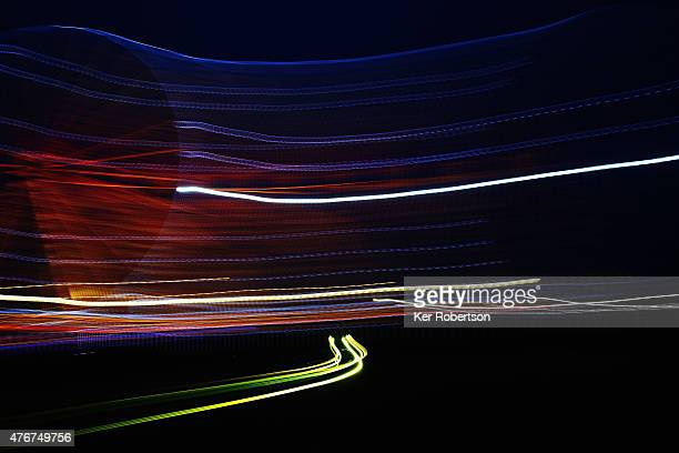 Cars drive past the ferris wheel during qualifying for the Le Mans 24 Hour race at the Circuit de la Sarthe on June 11 2015 in Le Mans France