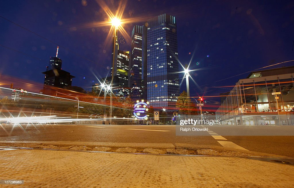 Cars drive past the headquarters of the European Central Bank (ECB) during a long time exposure on September 27, 2011 in Frankfurt am Main, Germany. Europe is continuing to wrestle with the ominous prospect of a Greek debt default that many fear could spread panic and push the already fragile economies of Italy, Portugal and Spain into a crisis that would rock the Eurozone and lead to global repercussions. On Thursday the Bundestag, under the urging of German Chancellor Angela Merkel, is expected to pass an increase in funding for the European Financial Stability Facility (EFSF), a measure many see as necessary for financial markets to regain confidence in the European banking system.