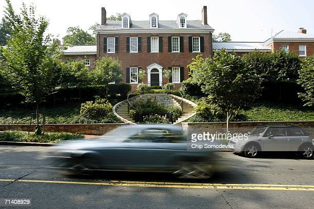 Cars drive past the large residence where Alan Senitt was stabbed and his throat was slashed in the driveway on July 10 2006 in a Georgetown...