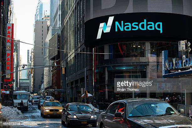 Cars drive past the NASDAQ MarketSite on March 2 2015 in New York City The NASDAQ composite climbed over 5000 points for the first time in 15 years...