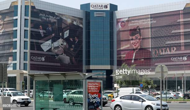 Cars drive past the Qatar Airways office in Doha on June 6 2017 A ban on Qatari flights imposed by Saudi Arabia and its allies took effect on June 6...