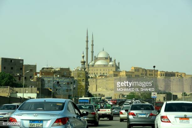 Cars drive past the Saladin Citadel a day ahead of the visit of Pope Francis in the capital Cairo on April 27 2017 Pope Francis is visiting Egypt on...