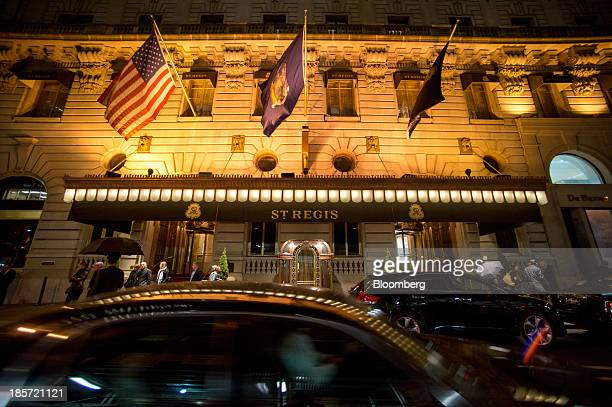 Cars drive past the St Regis Hotel a Starwood Hotels Resorts Worldwide Inc property in New York US on Wednesday Oct 23 2013 Starwood Hotels Resorts...