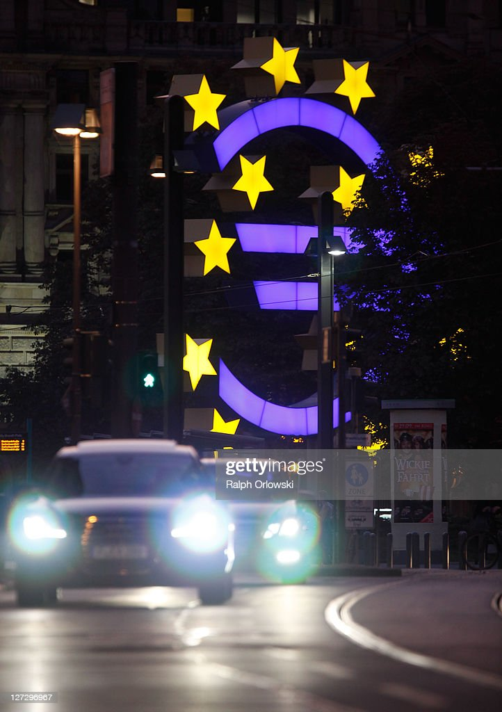 Cars drive past the symbol of the European common currency, the Euro at the headquarters of the European Central Bank (ECB) on September 27, 2011 in Frankfurt am Main, Germany. Europe is continuing to wrestle with the ominous prospect of a Greek debt default that many fear could spread panic and push the already fragile economies of Italy, Portugal and Spain into a crisis that would rock the Eurozone and lead to global repercussions. On Thursday the Bundestag, under the urging of German Chancellor Angela Merkel, is expected to pass an increase in funding for the European Financial Stability Facility (EFSF), a measure many see as necessary for financial markets to regain confidence in the European banking system.