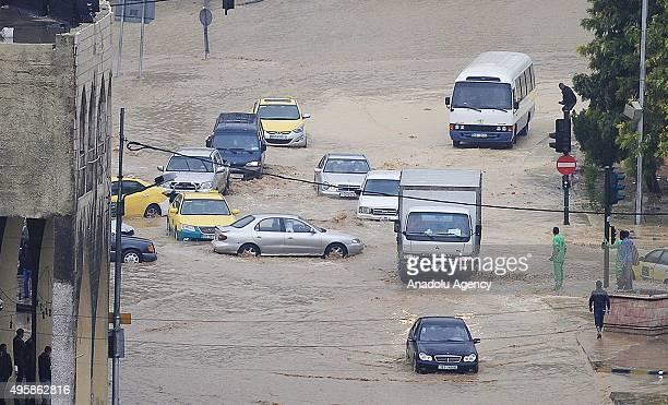 Cars drive through flooded street following heavy rains in Amman Jordan on 05 November 2015