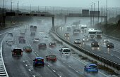 Cars drive through heavy rain at the Lymm interchange on the M6 in northwest England on September 25 2012 Flooding caused severe disruption to roads...