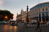 Cars drive through the streets on March 26 2012 in Havana Cuba Pope Benedict who will be arriving from Mexico will conduct a mass in the city of...