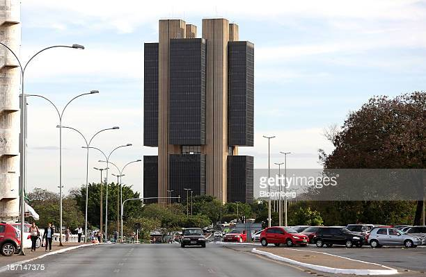 Cars drives past the headquarters of Brazil's Central Bank in the business district of Brasilia Brazil on Monday Sept 9 2013 Finance Minister Guido...