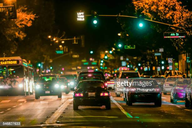 Cars driving in city traffic at night