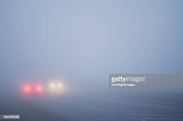 Cars driving in thick fog