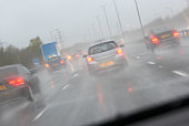 Cars Driving On A Rain Slicked Highway