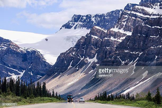 Cars driving on quiet road, Icefields Parkway, Alberta, Canada