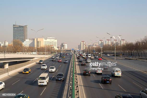 Cars driving on the ring road China's passenger car sales rose 99% in 2014 a solid result but a marked slowdown from 2013