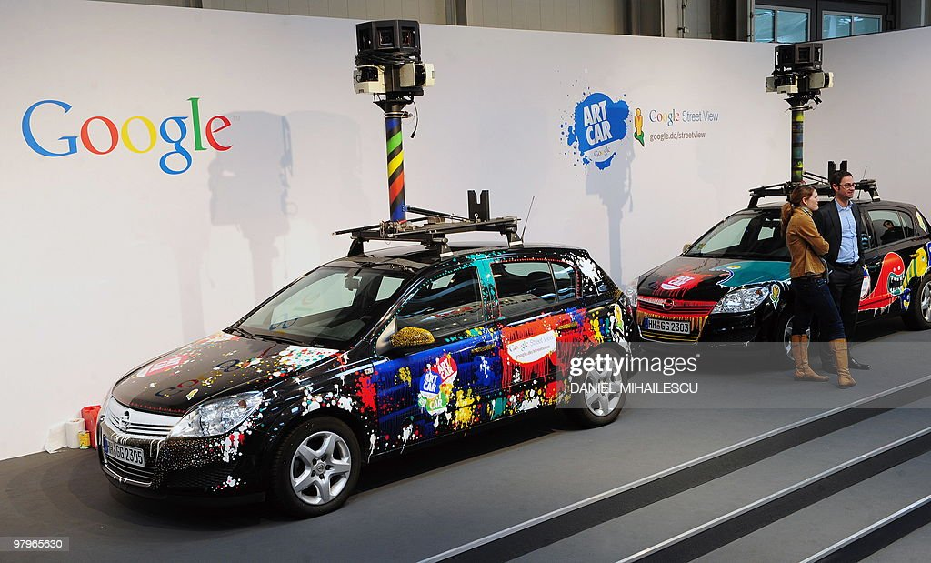 Cars equiped with special cameras, used to photograph whole streets, can be seen on the Google street-view stand at the world's biggest high-tech fair, the CeBIT on March 3, 2010 in the northern German city of Hanover. Some 4,157 companies from 68 countries are displaying their latest gadgets at the fair taking place from March 2 to 6, 2010. AFP PHOTO DANIEL MIHAILESCU
