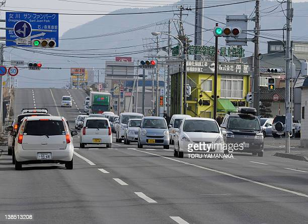 Cars fill a street which used to be filled with sea water in Ishinomaki Miyagi Prefecture on January 13 2012 nearly one year after the devastating...