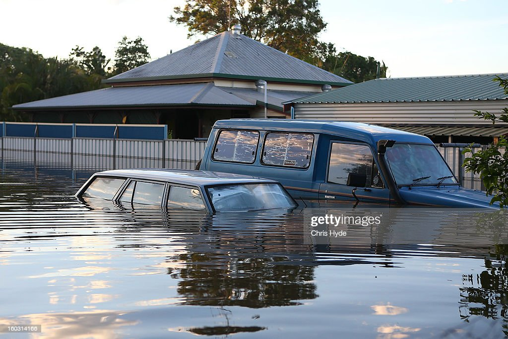 Cars float in a flooded street as parts of southern Queensland experiences record flooding in the wake of Tropical Cyclone Oswald on January 29, 2013 in Bundaberg, Australia.Four deaths have been confirmed and thousands have been evacuated in Bundaberg as the city faces it's worst flood disaster in history. Rescue and evacuation missions continue today as emergency services prepare to move patients from Bundaberg Hospital to Brisbane amid fears the hospital could lose power.