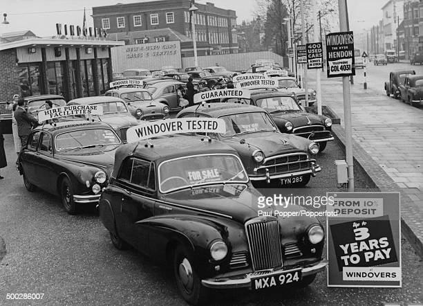 Cars for sale at the Windovers dealership in Hendon north London 8th November 1958 A sign advertises cars for sale with a deposit from 10 percent and...