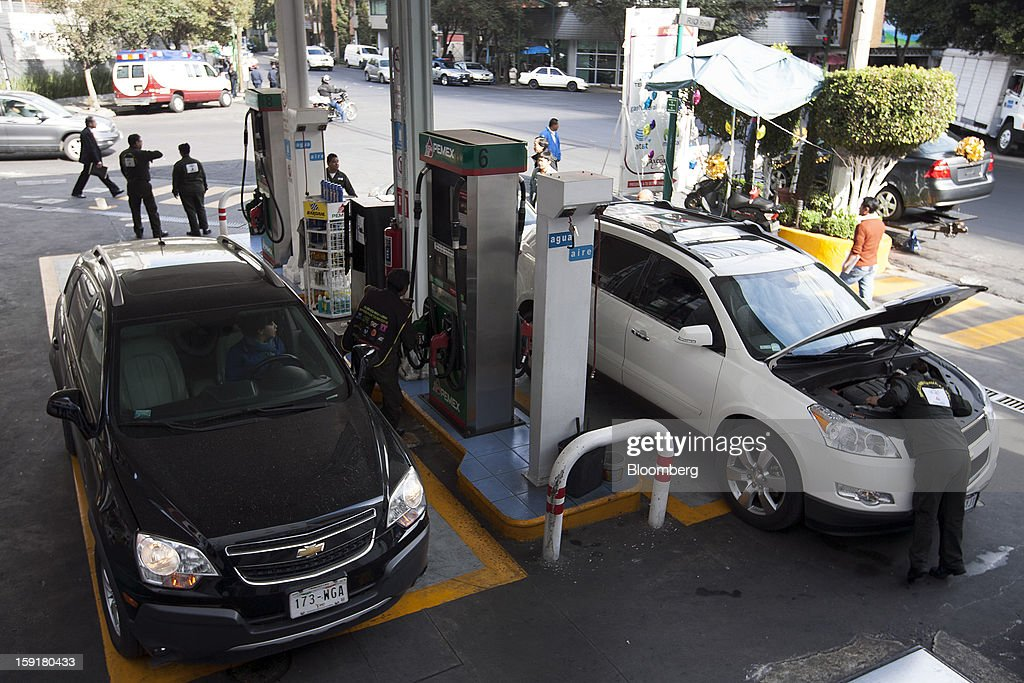 Cars get their tanks filled with gasoline at a Pemex station in Mexico City, Mexico, on Tuesday, Jan. 8, 2013. Mexico's government is speeding up the removal of subsidies on gasoline and increasing local unleaded gasoline prices by 11 centavos in January, according to the Finance Ministry. Photographer: Susana Gonzalez/Bloomberg via Getty Images
