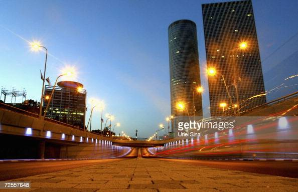 Cars go by on a highway next to Tel Aviv's landmark Azrieli Towers skyscraper complex on May 28 2004 in Tel Aviv Israel The United Nations...
