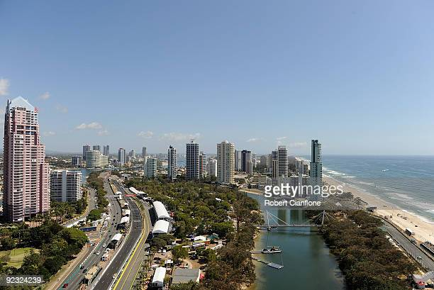 Cars head down the straight during qualifying for race 20A in round 11 of the V8 Supercar Championship Series at the Surfers Paradise Street Circuit...