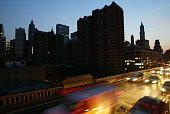 Cars head over the Brooklyn Bridge beside a blacked out New York City skyline August 14 2003 during a power outage The New York City comptroller...