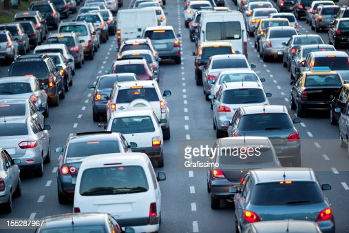 Cars in rush hour with traffic at dawn