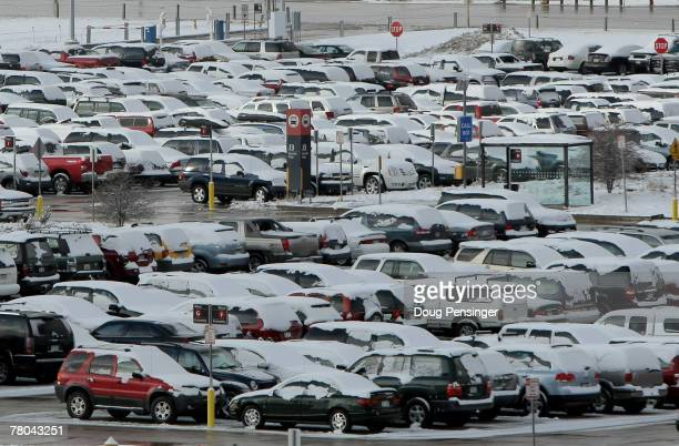 Cars in the parking lot are dusted with snow that fell overnight at the Denver International Airport on November 21 2007 in Denver Colorado Today is...