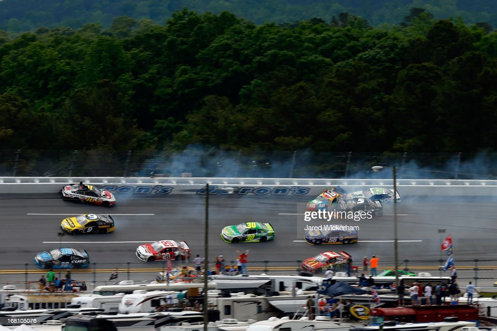 Cars including Greg Biffle, driver of the #16 3M Safety Ford, David Stremme, driver of the #30 Lean 1 Toyota, Kyle Busch, driver of the #18 M&M's Toyota, Jamie McMurray, driver of the #1 McDonald's Chevrolet, Martin Truex Jr., driver of the #56 NAPA Auto Parts Toyota, Kasey Kahne, driver of the #5 Time Warner Cable Chevrolet and David Stremme, driver of the #30 Lean 1 Toyota are involved in a wreck during the NASCAR Sprint Cup Series Aaron's 499 at Talladega Superspeedway on May 5, 2013 in Talladega, Alabama.