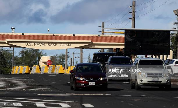 Cars leave the US Naval Base Guam on August 14 2017 in Santa Rita Guam The American territory of Guam remains on high alert as a showdown between the...