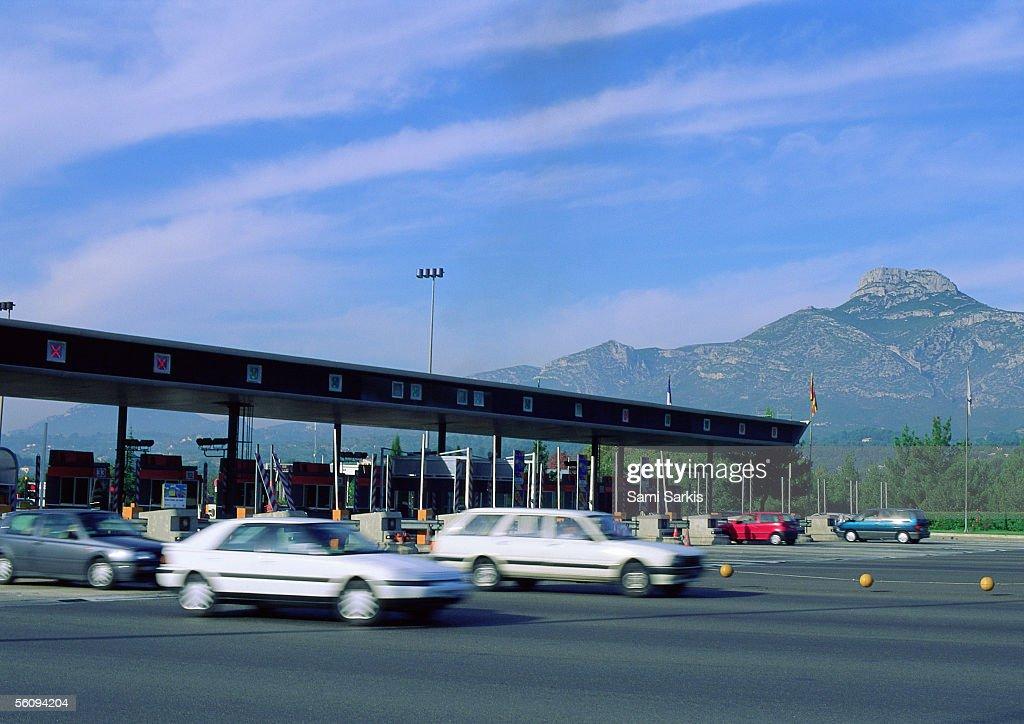 Cars leaving tollbooths