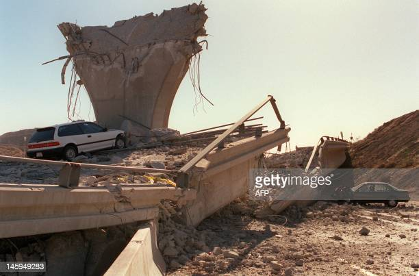 Cars lie smashed by the collapsed Interstate 5 connector few hours after Northridge earthquake on January 17 in Sylmar California Federal officials...