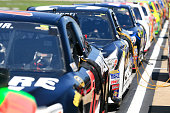 Cars line pit road during qualifying for the NASCAR Sprint Cup Series GEICO 500 at Talladega Superspeedway on May 2 2015 in Talladega Alabama
