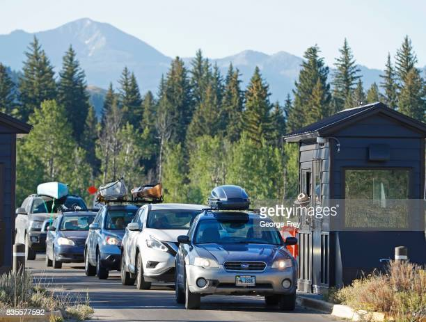 Cars line up at the south entrance to Grand Teton National Park on August 19 2017 outside Jackson Wyoming People are flocking to the Jackson and...