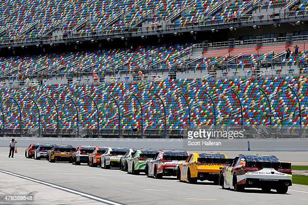 Cars line up on pit road during practice for the NASCAR XFINITY Series Subway Firecracker 250 at Daytona International Speedway on July 3 2015 in...