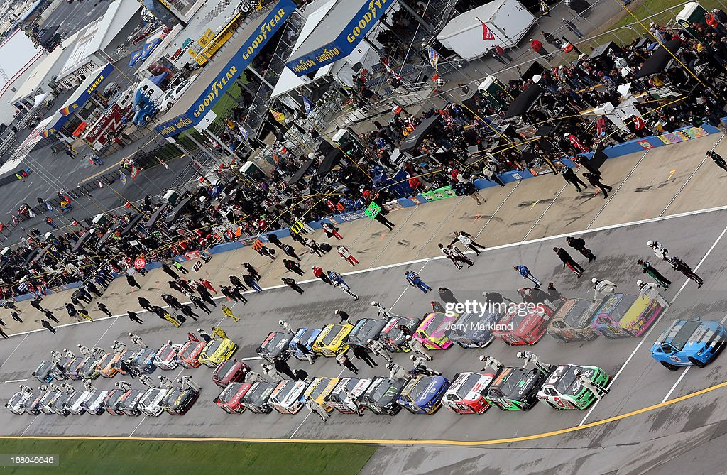 Cars line up on pit road prior to the start of the NASCAR Nationwide Series Aaron's 312 at Talladega Superspeedway on May 4, 2013 in Talladega, Alabama.