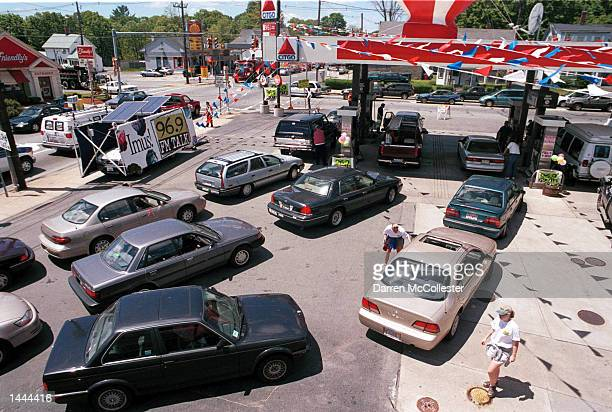 Cars line up to buy discounted gas May 26 2000 at a Citgo gas station in Woburn MA Many consumers flocked to this station which offered special low...